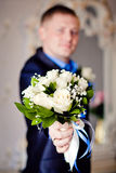 Groom Holding wedding bouquet of flowers Stock Image