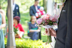 Groom holding a wedding bouquet Stock Photography