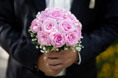 Groom holding a wedding bouquet Royalty Free Stock Photos