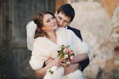 Groom holds the bride Royalty Free Stock Photography