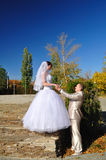 The groom holds the bride by hands Royalty Free Stock Photography