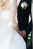 The groom holds the bride hands during the ceremony Royalty Free Stock Image