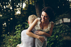 Groom holds bride in his arms Royalty Free Stock Photos