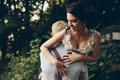 Groom holds bride in his arms Stock Image