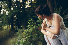 Groom holds bride in his arms Royalty Free Stock Photography