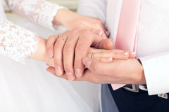 Groom holds the bride's hand royalty free stock photo