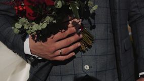 The groom holds the bride`s hand with the ring on your finger stock video footage