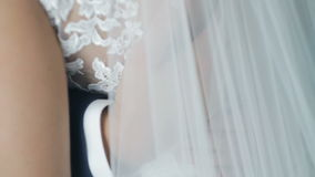 Groom holds bride`s waist close-up stock video footage