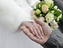 Groom holds the hand of fiancee Royalty Free Stock Images