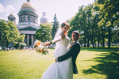 Groom holds his bride Stock Photos