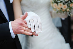 Groom holds his bride's hand Stock Image