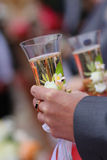 Groom holds wedding champagne glass Stock Images