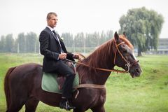 Groom on horse Royalty Free Stock Images