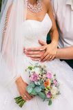 Groom hug the bride with beautiful wedding bouquet Stock Images
