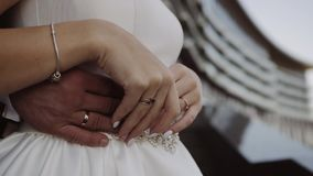Groom hugging the bride from behind stock footage