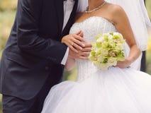 Groom Hugging bride Stock Images