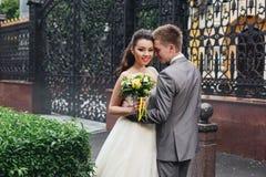 A groom hugging his bride royalty free stock image
