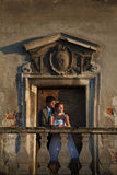 Groom is huging his bride on background old beautiful door.  royalty free stock photography