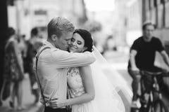 Groom hugs bride Stock Image