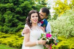 Groom hugs the bride`s shoulder Royalty Free Stock Image