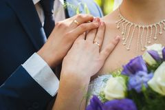 Groom husband, gently holds the hand of the bride wife stock photos