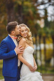 The groom kisses the bride in Park in the summer. Stock Photo