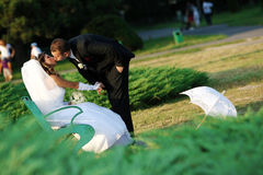 Groom kissing the bride. In the park Stock Image