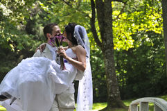 Groom kissing the bride Royalty Free Stock Photography