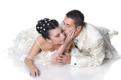 Groom kissing bride Royalty Free Stock Photography