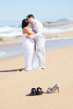 Groom kissing bride. On beach Royalty Free Stock Images