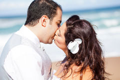 Groom kissing bride Stock Image