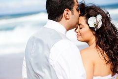 Groom kissing bride Stock Photo