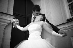 Groom kissing bride from back Royalty Free Stock Photos