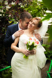Groom kissing bride in neck at jungle Royalty Free Stock Photo