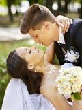 Groom kissing bride. Groom kissing bride outdoor Stock Photos