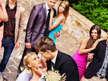 Groom kissing bride in park. Outdoor Stock Photo