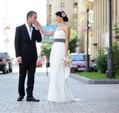 Groom kissing bride's hand Royalty Free Stock Photo