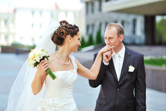 Groom kissing bride's hand while walking together Royalty Free Stock Photos