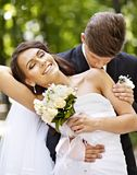 Groom kissing bride on shoulder . Stock Images
