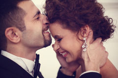 Groom kissing the bride. And smiling Stock Photo