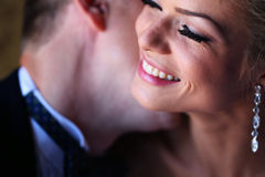 Groom kissing the bride in a soft light. Lovely Stock Images