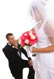 Groom Kissing Bride at Wedding Stock Photography