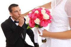 Groom Kissing Bride at Wedding Stock Photography