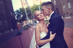 Groom kissing his bride Stock Photo