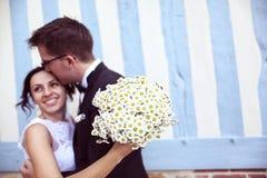 Groom kissing his bride Royalty Free Stock Image