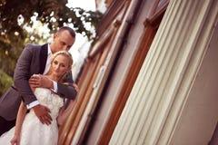 Groom kissing his bride Stock Photo