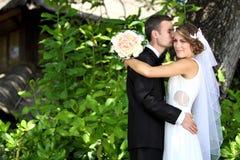 Groom kissing his bride Royalty Free Stock Photo