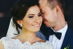 Groom leans to a perfect bride`s face Stock Image