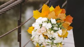 The Groom Leaves the Bridal Bouquet. Slow motion stock footage