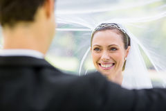 Groom lifting bridal veil Stock Photo